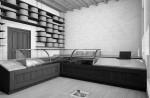 negozio caseificio stile classico con banco vendita in rovere tinto e piano top in agglomerato di quarzo ed elementi d'arredo in rovere tinto ed acciaio, desig